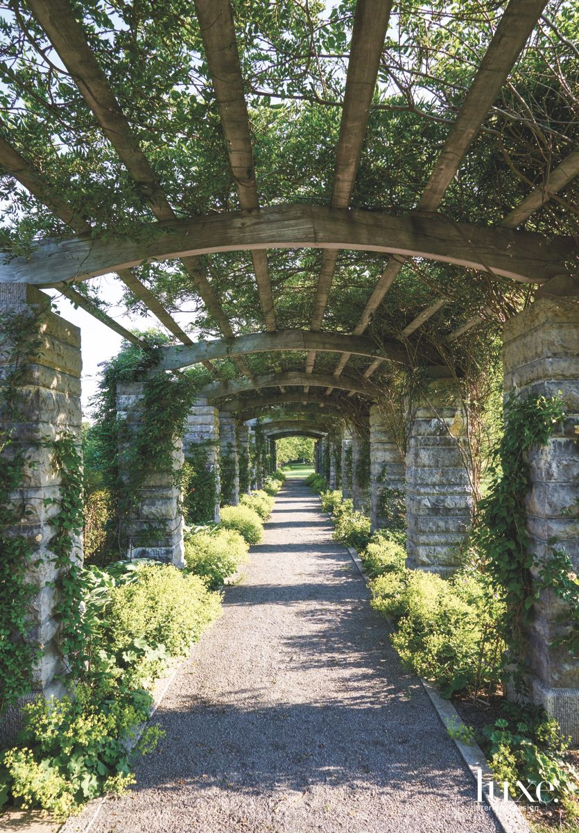 Long Walk Pergola Terrace Covering with Old Stone and Plant Growth