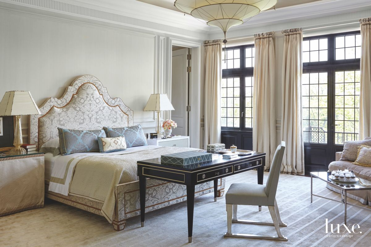 Upholstered Headboard Master Bedroom with Whimsical Chandelier and Desk