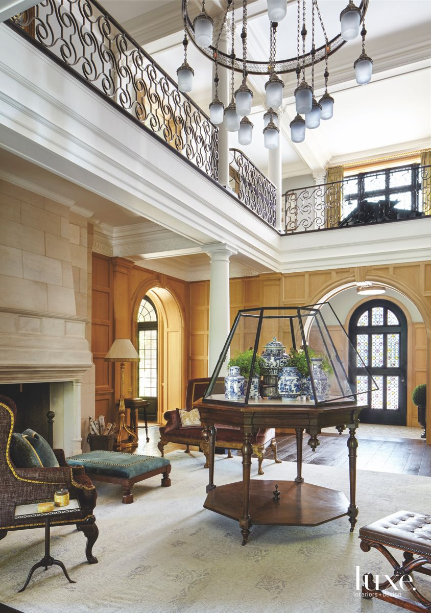 Coffered Wooden Walls Entry with Traditional Furniture and Large Fireplace