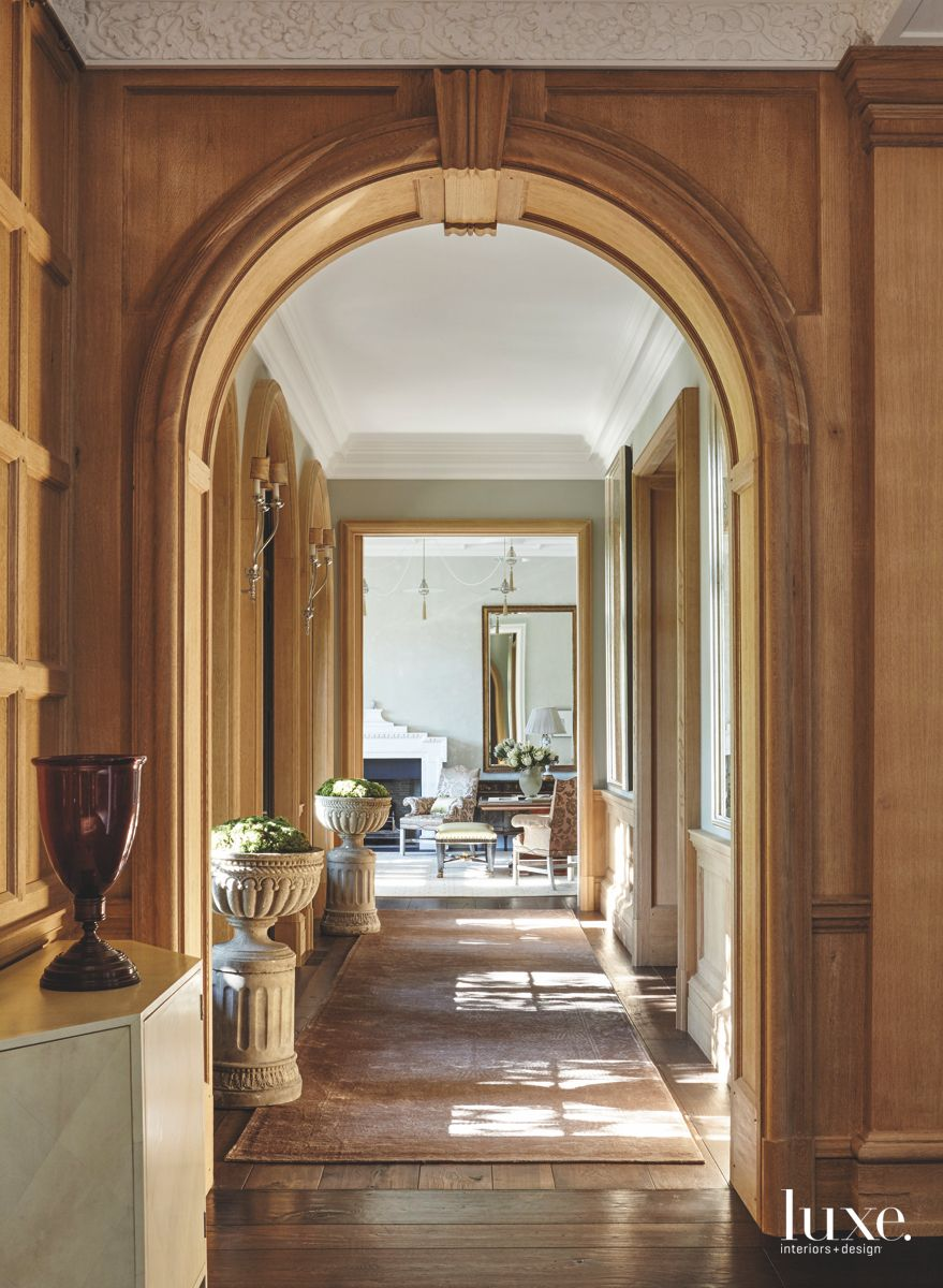 Stucco Ceiling Arched Doorway with Traditional Flourishes and Plants