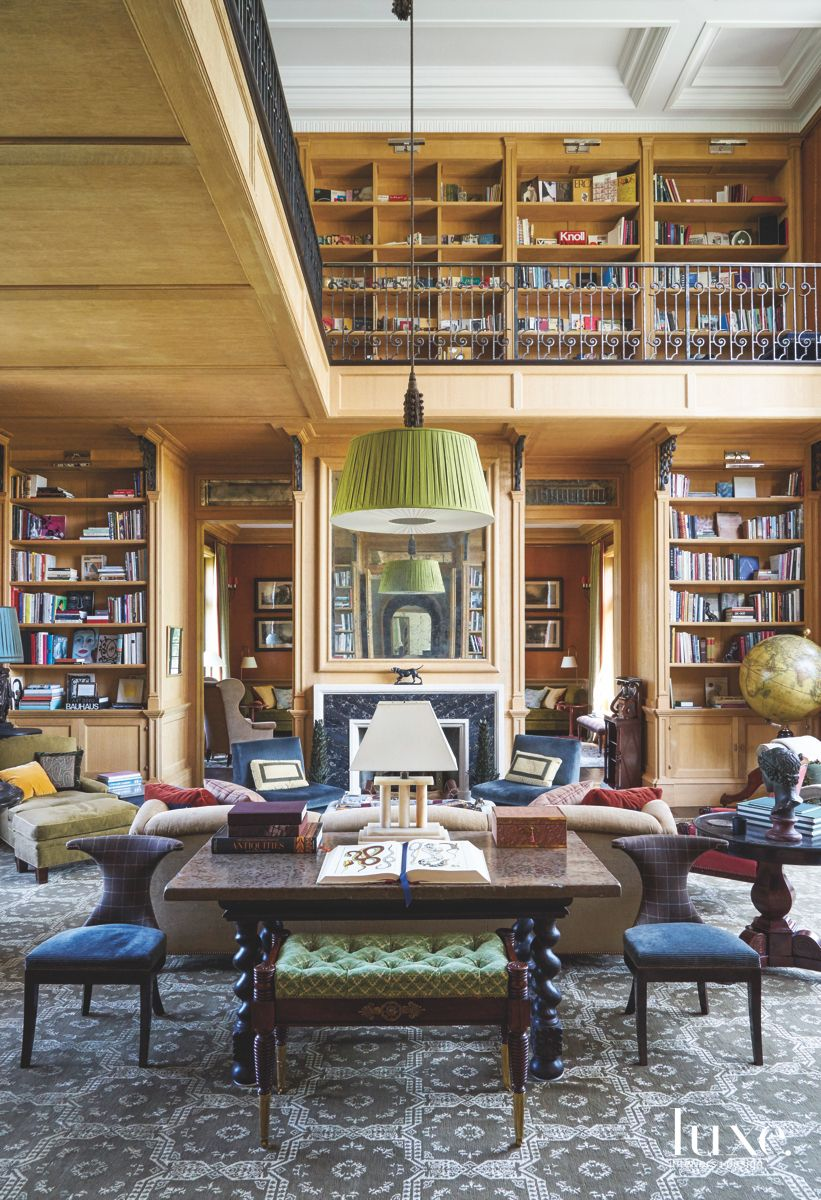 Two Story Massive Library with Low Hanging Light Fixture and Plenty of Seating