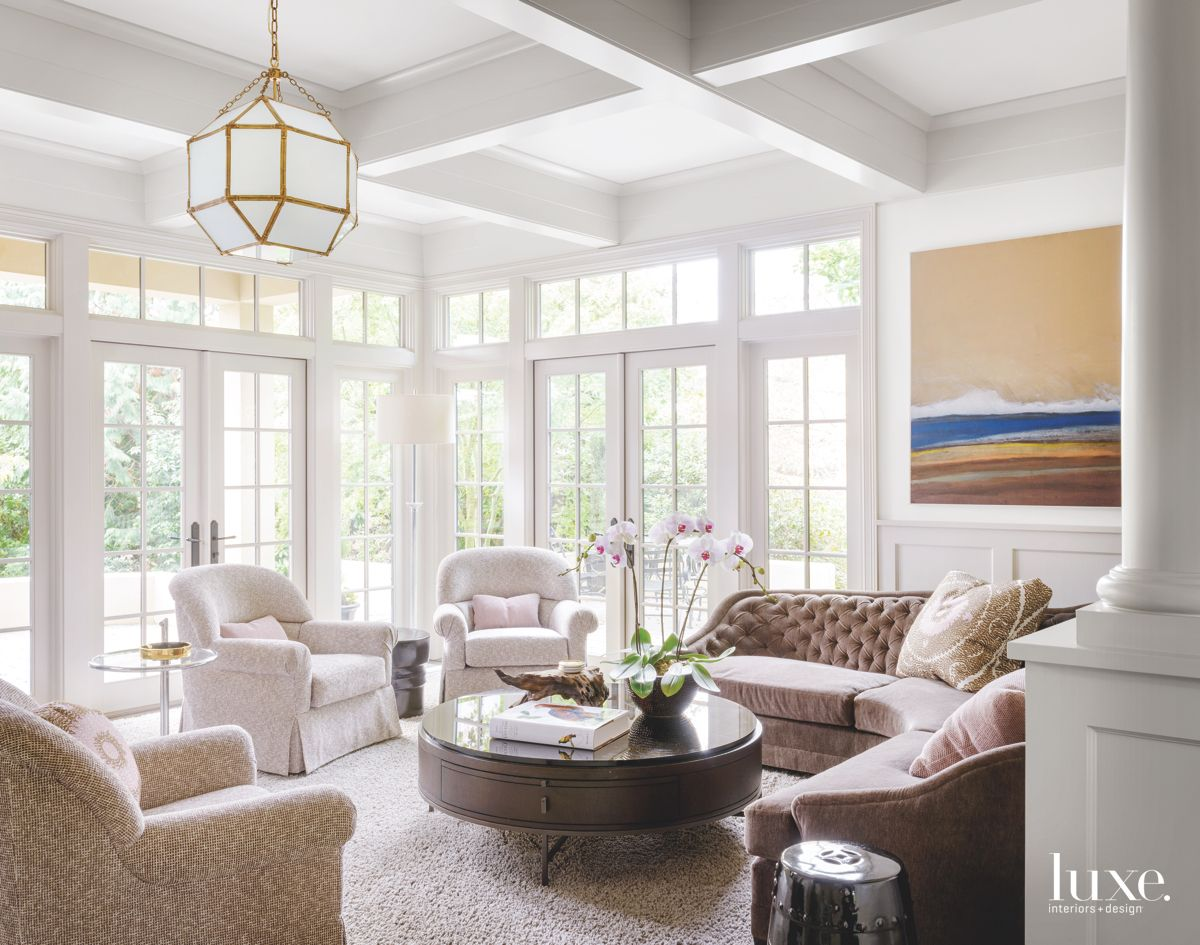 Well-Lit Family Room with Chandelier and Vignette