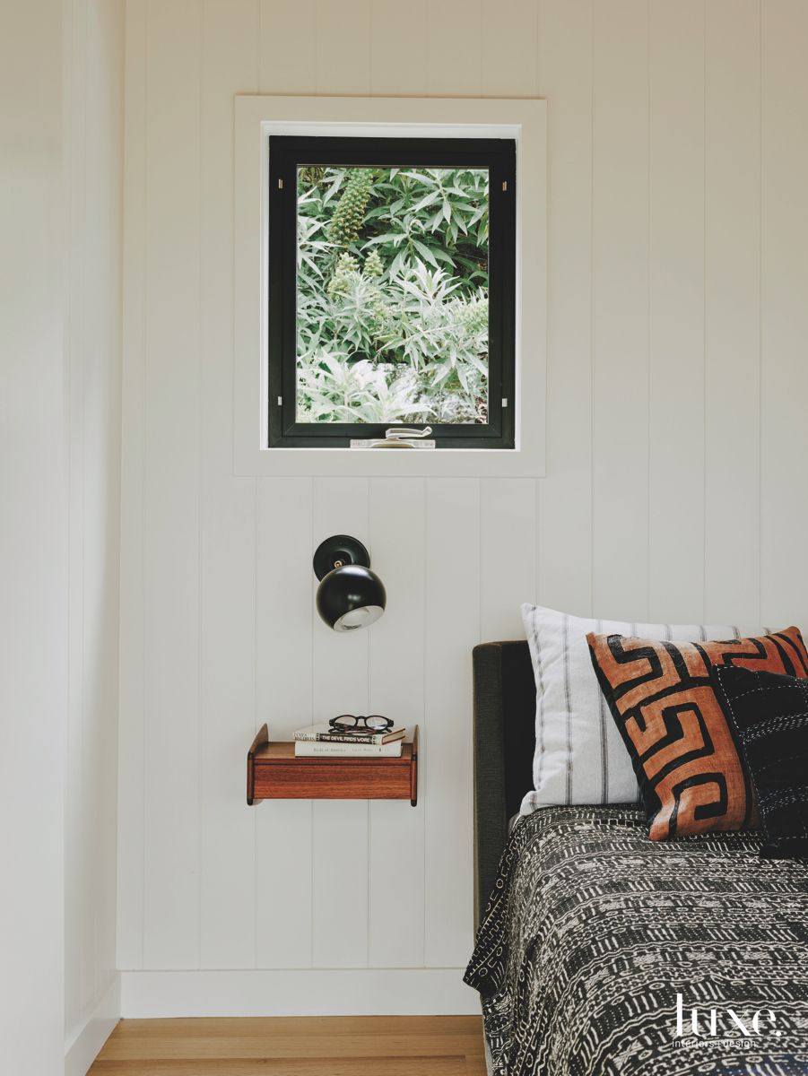 Small Window Master Bedroom with Sconce with Floating Side Table