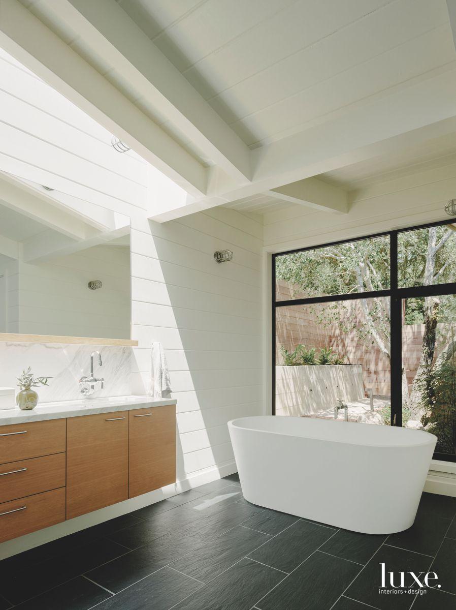 Skylight Master Bathroom with Large Soaking Tub and Vanity