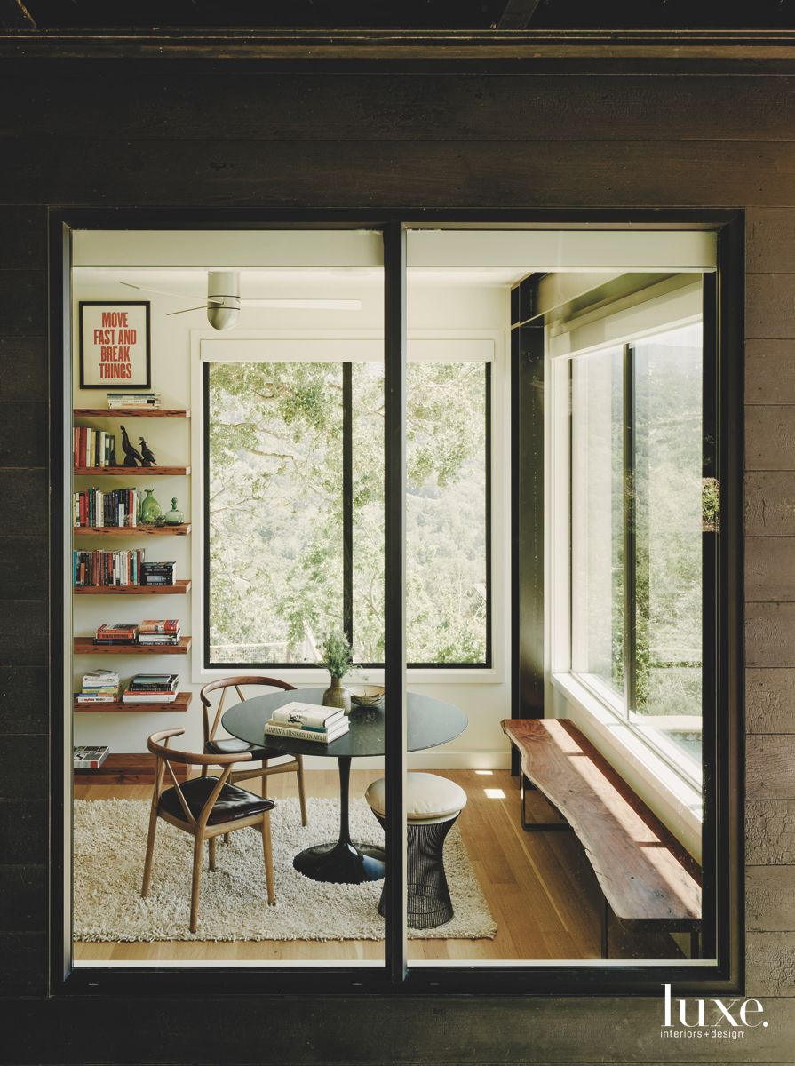Glass and Light Filled Family Room with Library Shelves Bench and Seating