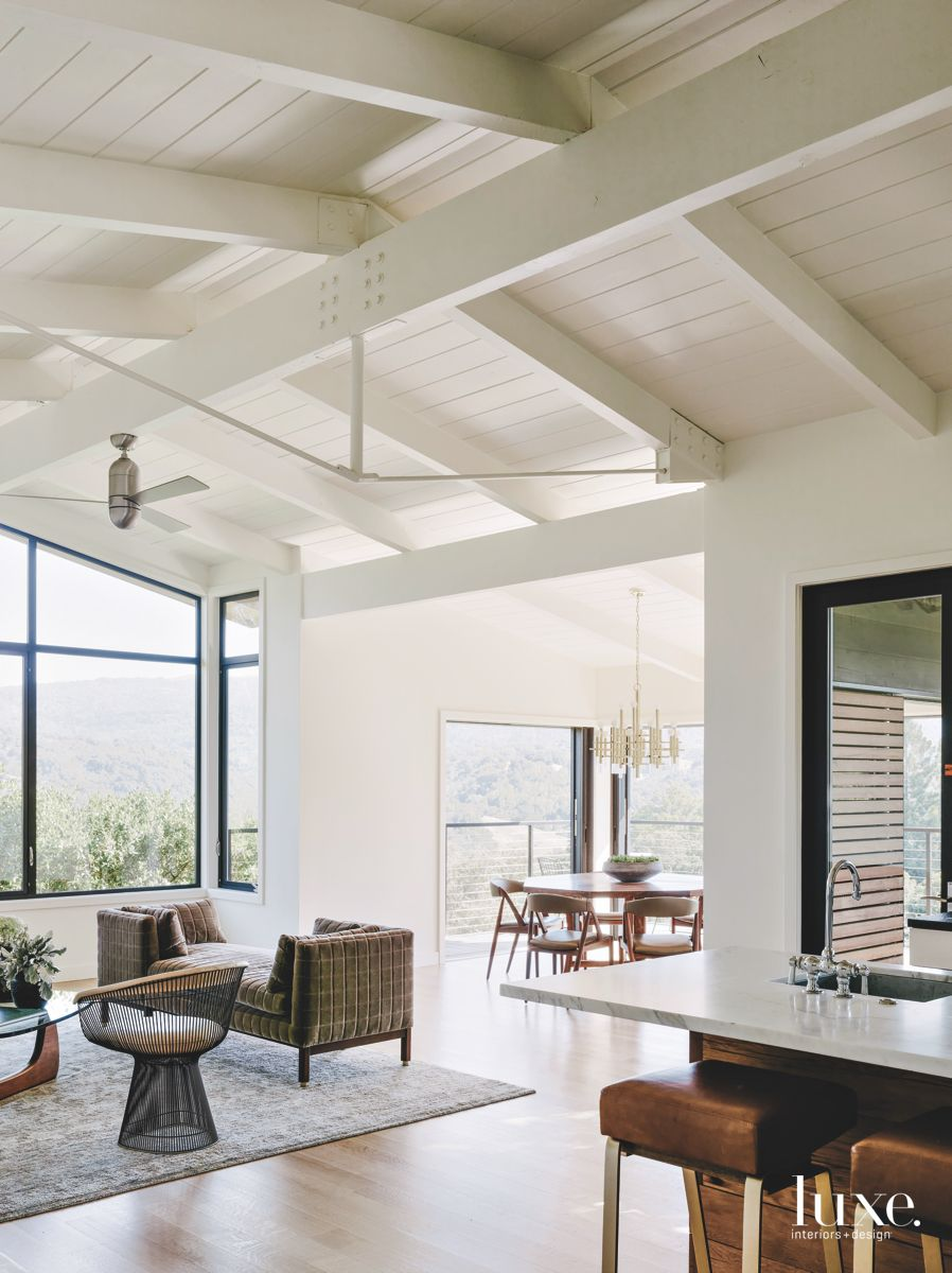 Beamed Ceiling White Living Room with Contemporary Furniture and Ceiling Fans