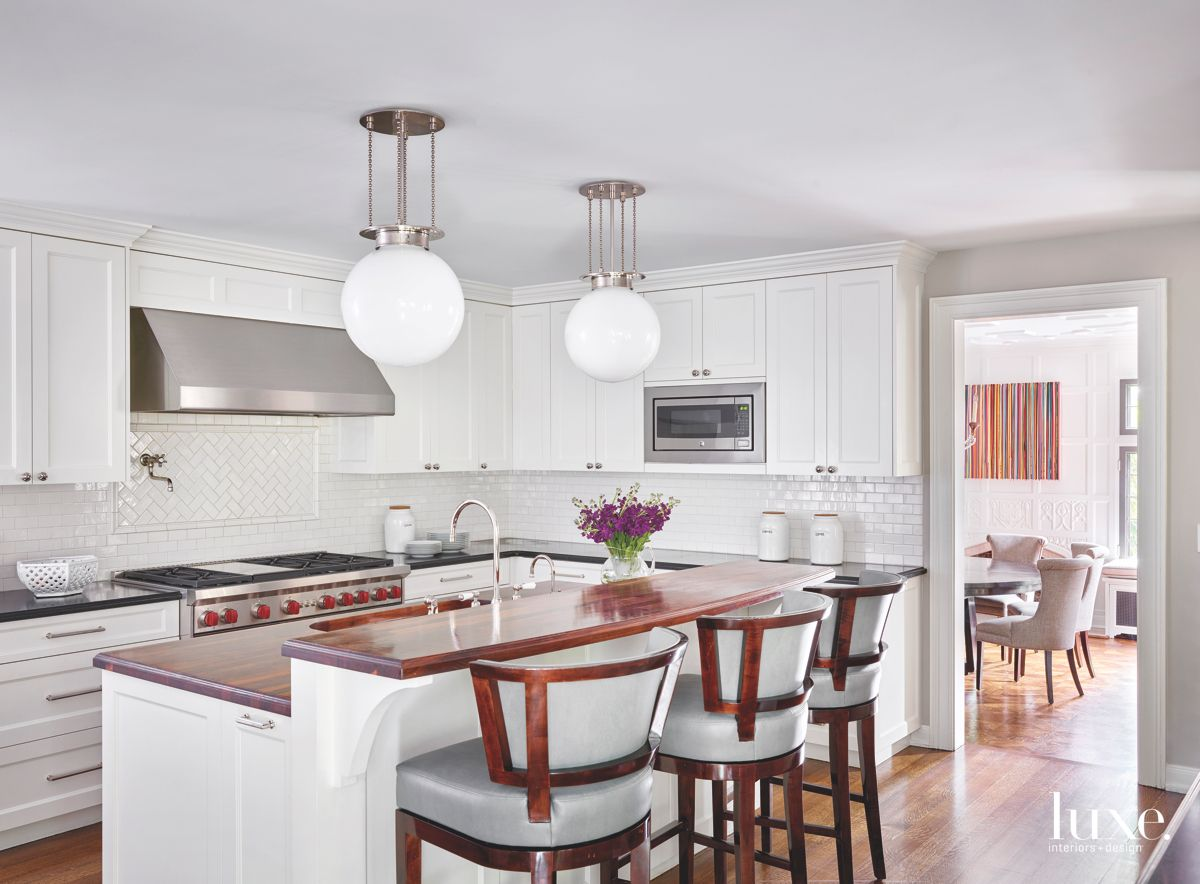 Shaker Style All White Kitchen with Spherical Pendant Lighting and Subway Tile