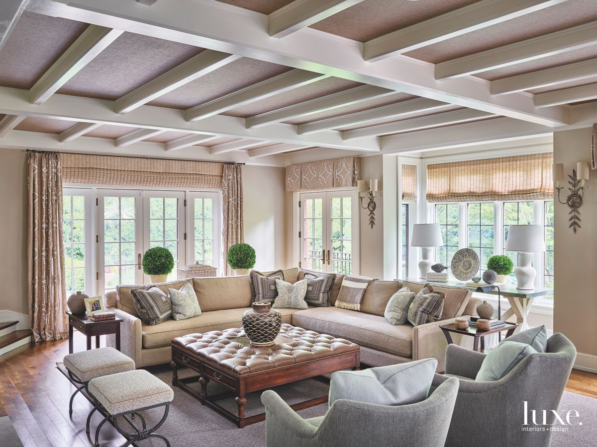 Neutral Coffered Ceiling Living Room with Corner Sofa Leather Ottoman and Plants