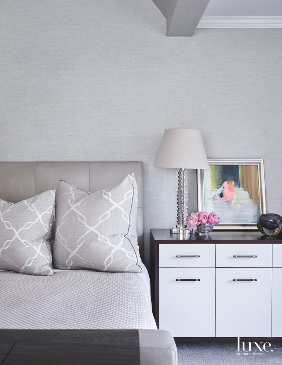 Cool Gray Master Bedroom with Patterned Pillows Framed Artwork and Lamp with Storage Side Table