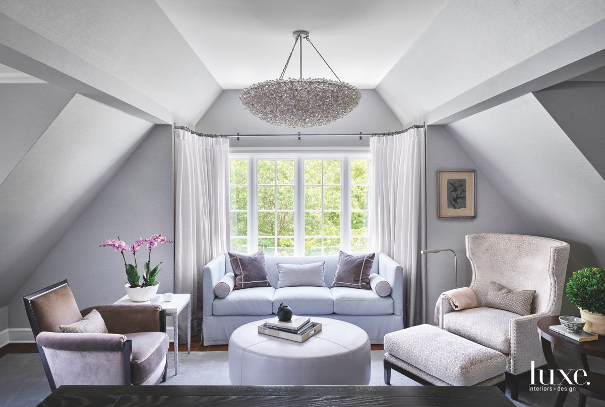 Stark Cool Gray Sitting Area with Dazzling Chandelier and Lots of Seating