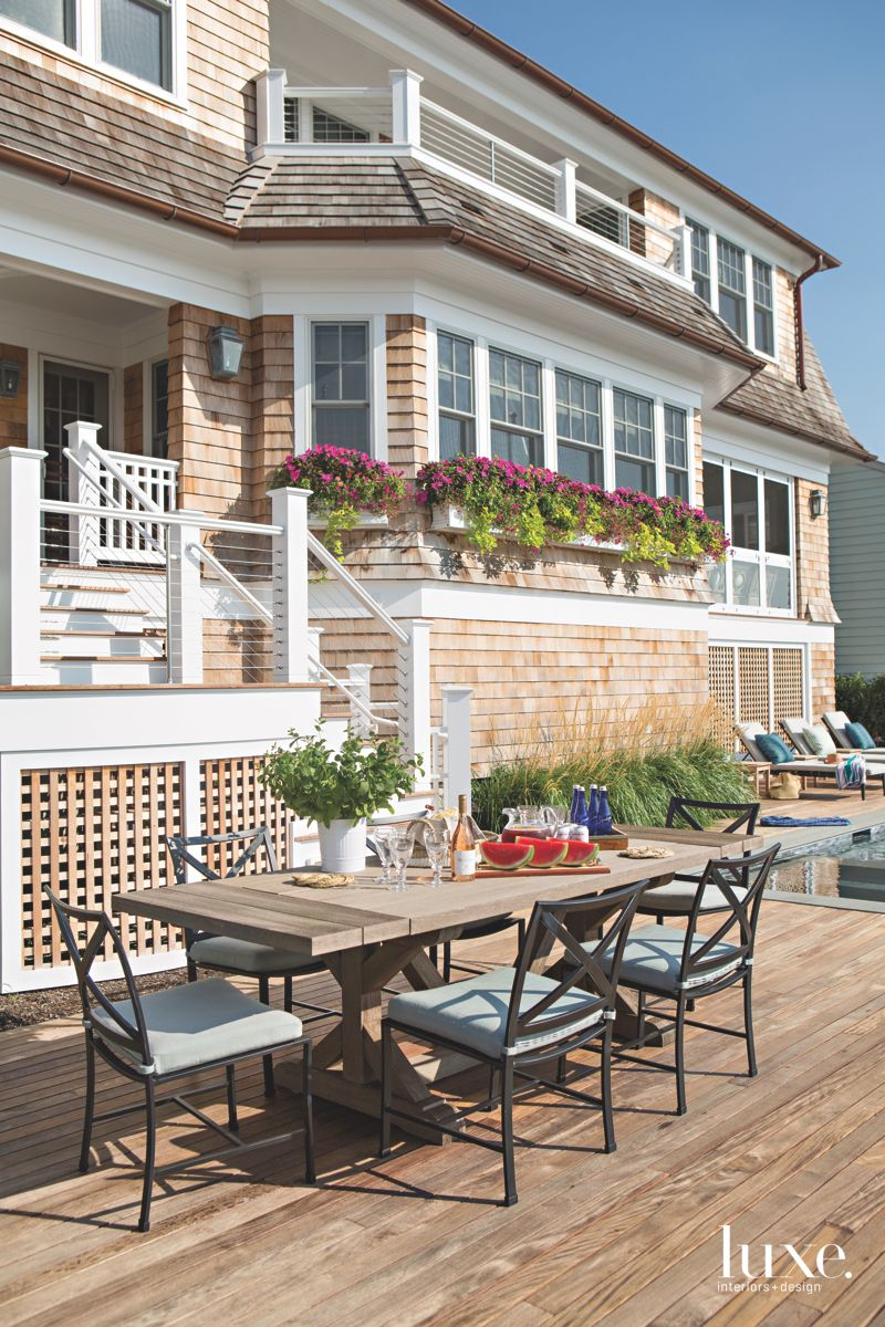 Wooden Waterside Deck with Metal Outdoor Furniture
