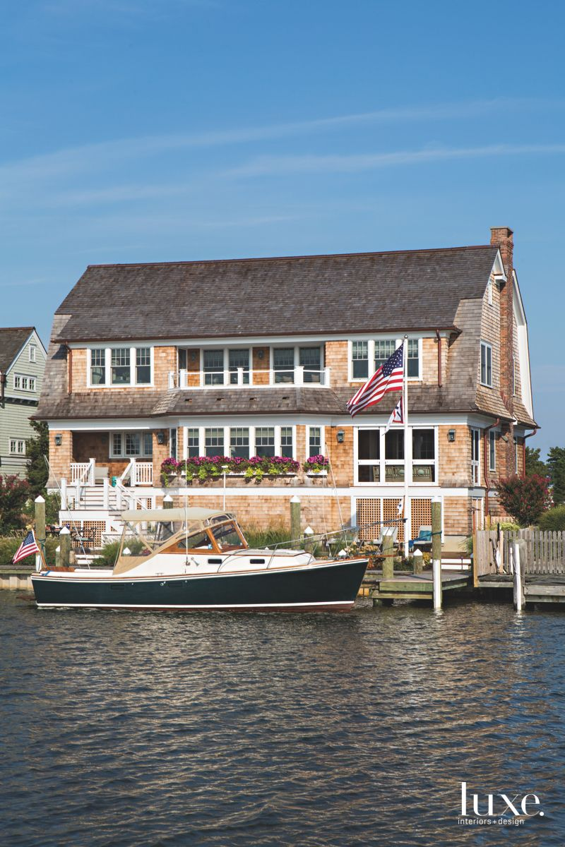 Wooden Shingle Home Exterior with Boat and Private Dock