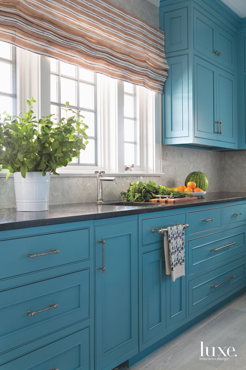 Strong Blue Cabinet Kitchen with Striped Warm Colored Roman Shades