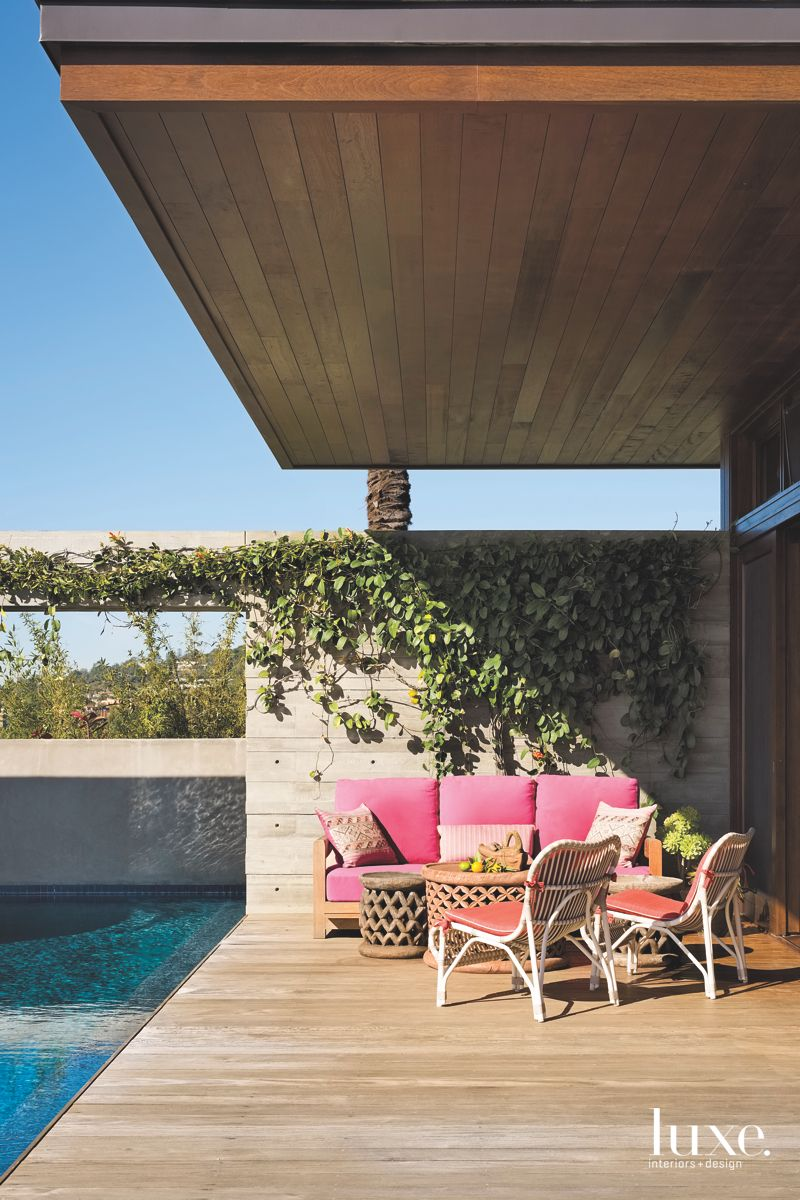 Pink Outdoor Furniture Sustainable Deck with Vegetation Landscaping Poolside