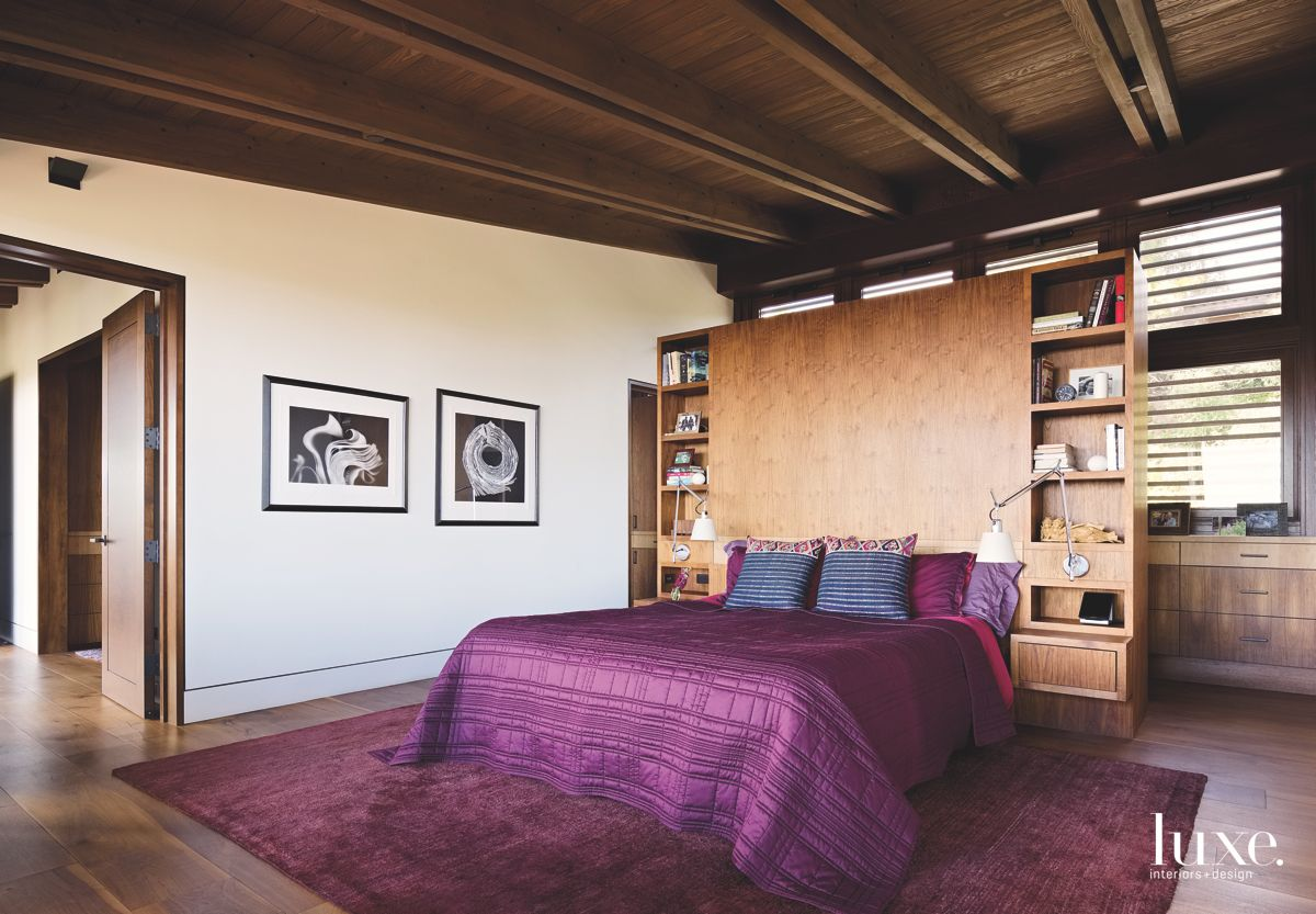 Wooden Backboard Master Bedroom with Black and White Art and Purple Accents