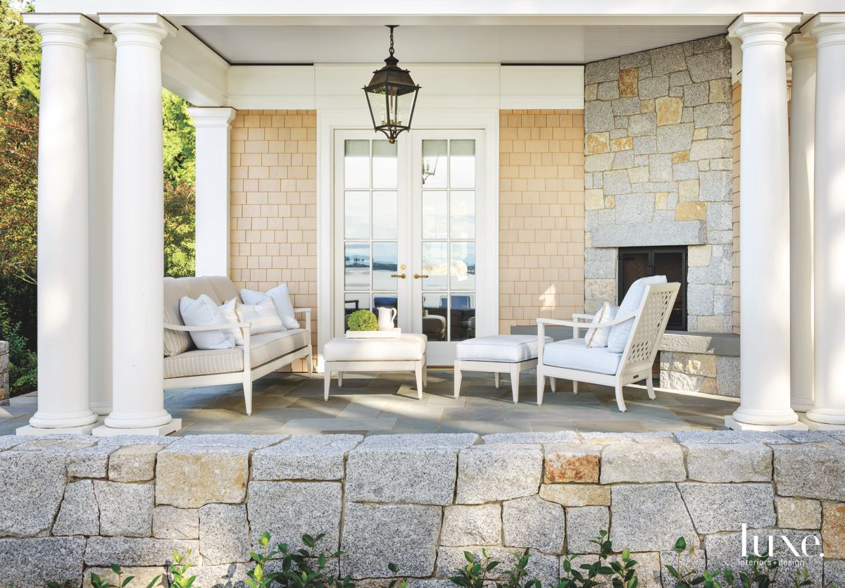 Sheltered Outdoor Living Room with Stone Fireplace and Seating