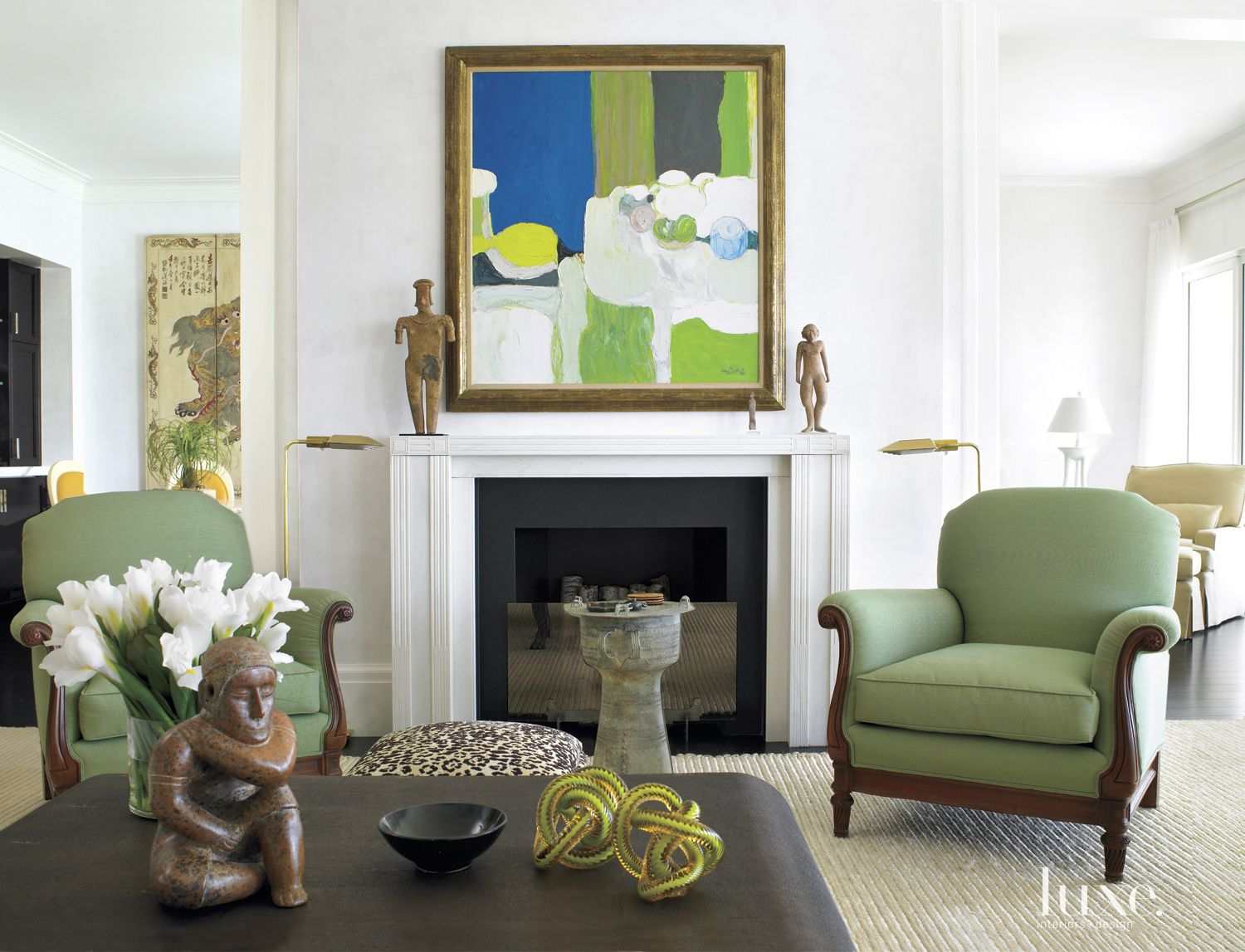 Eclectic White Living Room with Green Chairs