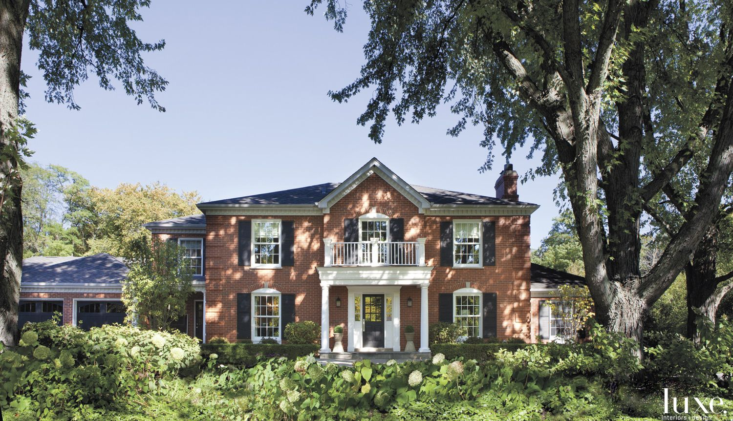 Traditional Brick Front Elevation with Black Shutters