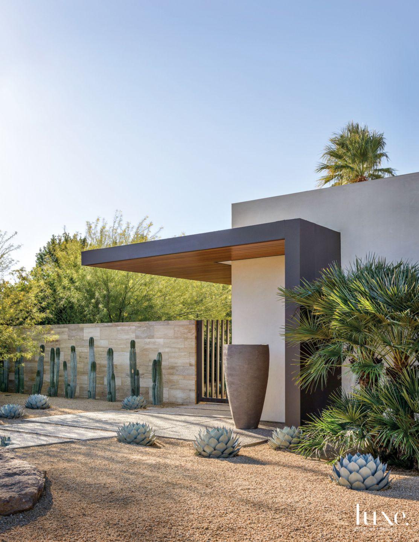 Modern Cream Exterior with Desert Landscape